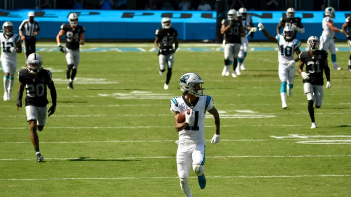 CHARLOTTE, NORTH CAROLINA - SEPTEMBER 13: Robby Anderson #11 of the Carolina Panthers breaks free for a touchdown against the Las Vegas Raiders at Bank of America Stadium on September 13, 2020 in Charlotte, North Carolina. Las Vegas won 34-30. (Photo by Grant Halverson/Getty Images)
