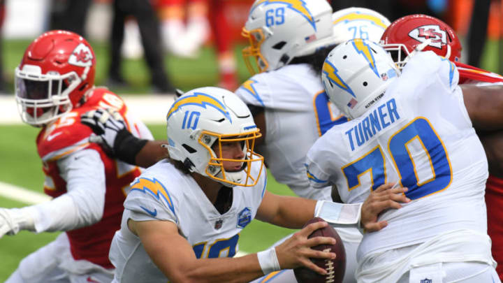 INGLEWOOD, CALIFORNIA - SEPTEMBER 20: Quarterback Justin Herbert #10 of the Los Angeles Chargers scrambles against the Kansas City Chiefs during the first half at SoFi Stadium on September 20, 2020 in Inglewood, California. (Photo by Harry How/Getty Images)