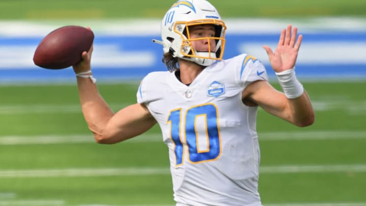 INGLEWOOD, CALIFORNIA - SEPTEMBER 20: Quarterback Justin Herbert #10 of the Los Angeles Chargers throws a pass against the Kansas City Chiefs during the first half at SoFi Stadium on September 20, 2020 in Inglewood, California. (Photo by Harry How/Getty Images)