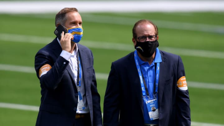 INGLEWOOD, CALIFORNIA - SEPTEMBER 20: (R-L) Owner of the Los Angeles Chargers Dean Spanos, with son A.G. Spanos on the field before the game against the Kansas City Chiefs at SoFi Stadium on September 20, 2020 in Inglewood, California. (Photo by Harry How/Getty Images)