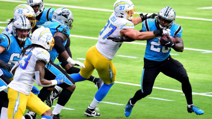 INGLEWOOD, CALIFORNIA - SEPTEMBER 27: Mike Davis #28 of the Carolina Panthers is tackled by Joey Bosa #97 of the Los Angeles Chargers on third down during the second quarter at SoFi Stadium on September 27, 2020 in Inglewood, California. (Photo by Harry How/Getty Images)