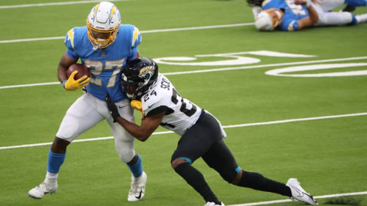 INGLEWOOD, CALIFORNIA - OCTOBER 25: Joshua Kelley #27 of the Los Angeles Chargers runs the ball against Josiah Scott #24 of the Jacksonville Jaguars during the fourth quarter at SoFi Stadium on October 25, 2020 in Inglewood, California. (Photo by Katelyn Mulcahy/Getty Images)