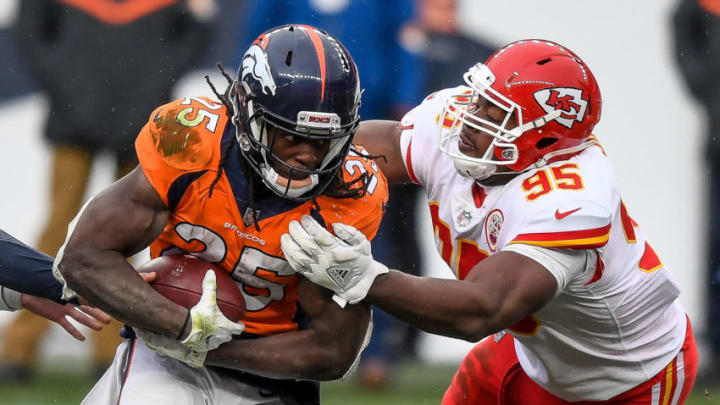 DENVER, CO - OCTOBER 25: Melvin Gordon #25 of the Denver Broncos rushes against Chris Jones #95 of the Kansas City Chiefs in the fourth quarter of a game at Empower Field at Mile High on October 25, 2020 in Denver, Colorado. (Photo by Dustin Bradford/Getty Images)