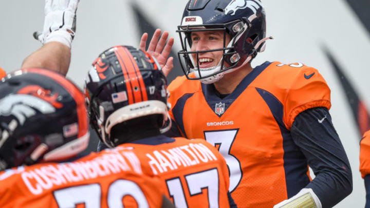 DENVER, CO - OCTOBER 25: Drew Lock #3 of the Denver Broncos smiles as he celebrates a first quarter touchdown against the Kansas City Chiefs at Empower Field at Mile High on October 25, 2020 in Denver, Colorado. (Photo by Dustin Bradford/Getty Images)