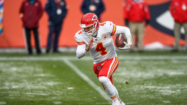 DENVER, CO - OCTOBER 25: Chad Henne #4 of the Kansas City Chiefs carries the ball for a fourth quarter touchdown against the Denver Broncos during a game at Empower Field at Mile High on October 25, 2020 in Denver, Colorado. (Photo by Dustin Bradford/Getty Images)