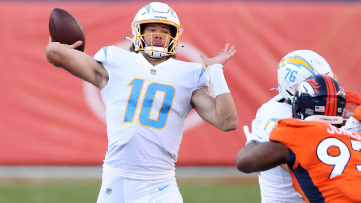 DENVER, COLORADO - NOVEMBER 01: Quarterback Justin Herbert #10 of the Los Angeles Chargers looks to pass against Dre'Mont Jones #93 of the Denver Broncos in the second quarter of the game at Empower Field At Mile High on November 01, 2020 in Denver, Colorado. (Photo by Matthew Stockman/Getty Images)