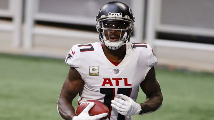 ATLANTA, GEORGIA - NOVEMBER 08: Julio Jones #11 of the Atlanta Falcons reacts after scoring a touchdown during the third quarter against the Denver Broncos at Mercedes-Benz Stadium on November 08, 2020 in Atlanta, Georgia. (Photo by Kevin C. Cox/Getty Images)