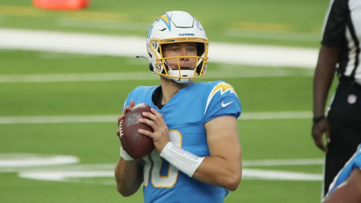 INGLEWOOD, CALIFORNIA - NOVEMBER 22: Justin Herbert #10 of the Los Angeles Chargers looks to pass during the first half against the New York Jets at SoFi Stadium on November 22, 2020 in Inglewood, California. (Photo by Katelyn Mulcahy/Getty Images)