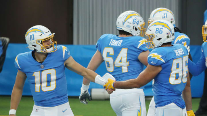 INGLEWOOD, CALIFORNIA - NOVEMBER 22: Justin Herbert #10 of the Los Angeles Chargers celebrates a touchdown with Hunter Henry #86 during the second half against the New York Jets at SoFi Stadium on November 22, 2020 in Inglewood, California. (Photo by Katelyn Mulcahy/Getty Images)