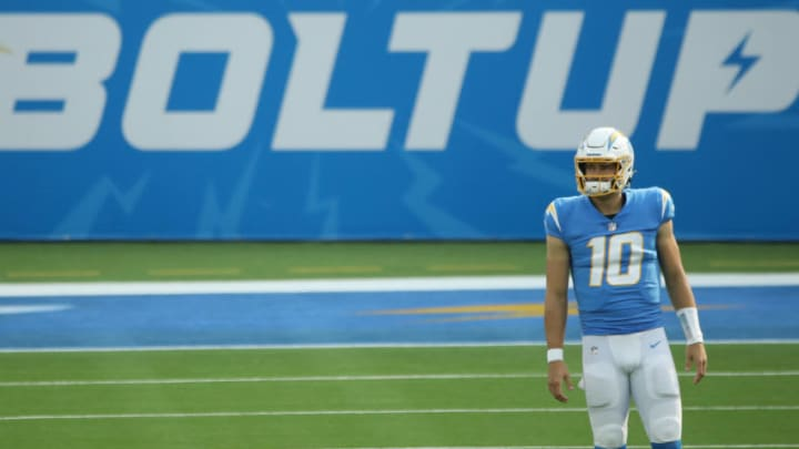 INGLEWOOD, CALIFORNIA - NOVEMBER 22: Justin Herbert #10 of the Los Angeles Chargers looks on before the game against the New York Jets at SoFi Stadium on November 22, 2020 in Inglewood, California. (Photo by Katelyn Mulcahy/Getty Images)