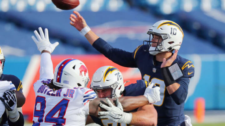 ORCHARD PARK, NEW YORK - NOVEMBER 29: Justin Herbert #10 of the Los Angeles Chargers releases the ball during the first quarter against the Buffalo Bills at Bills Stadium on November 29, 2020 in Orchard Park, New York. (Photo by Timothy T Ludwig/Getty Images)