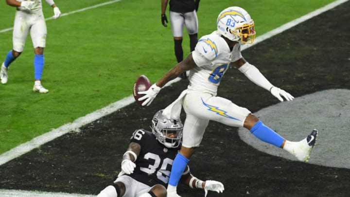 LAS VEGAS, NEVADA - DECEMBER 17: Wide receiver Tyron Johnson #83 of the Los Angeles Chargers celebrates scoring a touchdown as Daryl Worley #36 of the Las Vegas Raiders looks on during the first half at Allegiant Stadium on December 17, 2020 in Las Vegas, Nevada. (Photo by Ethan Miller/Getty Images)