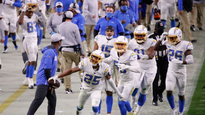 LAS VEGAS, NEVADA - DECEMBER 17: Cornerback Chris Harris #25 of the Los Angeles Chargers celebrates after an interception against the Las Vegas Raiders during the fourth quarter of the NFL game at Allegiant Stadium on December 17, 2020 in Las Vegas, Nevada. The Chargers defeated the Raiders in overtime 30-27. (Photo by Christian Petersen/Getty Images)