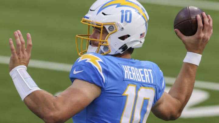 INGLEWOOD, CALIFORNIA - DECEMBER 27: Justin Herbert #10 of the Los Angeles Rams warms up before playing against the Denver Broncos at SoFi Stadium on December 27, 2020 in Inglewood, California. (Photo by Sean M. Haffey/Getty Images)