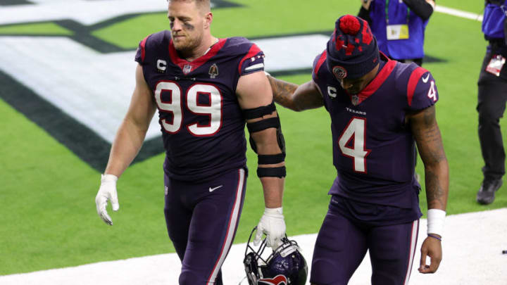 HOUSTON, TEXAS - JANUARY 03: J.J. Watt #99 of the Houston Texans walks off the field with Deshaun Watson #4 following a game against the Tennessee Titans at NRG Stadium on January 03, 2021 in Houston, Texas. (Photo by Carmen Mandato/Getty Images)