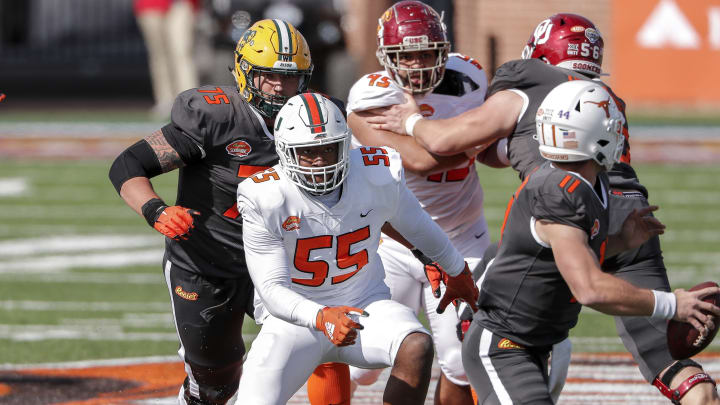 Defensive Lineman Quincy Roche #55 from Miami rushes Quarterback Sam Ehlinger #11 from Texas (Photo by Don Juan Moore/Getty Images)