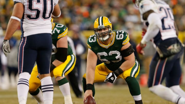 GREEN BAY, WI - NOVEMBER 30: Center Corey Linsley #63 of the Green Bay Packers prepares to snap the football during the NFL game against the New England Patriots at Lambeau Field on November 30, 2014 in Green Bay, Wisconsin. The Packers defeated the Patriots 26-21. (Photo by Christian Petersen/Getty Images)