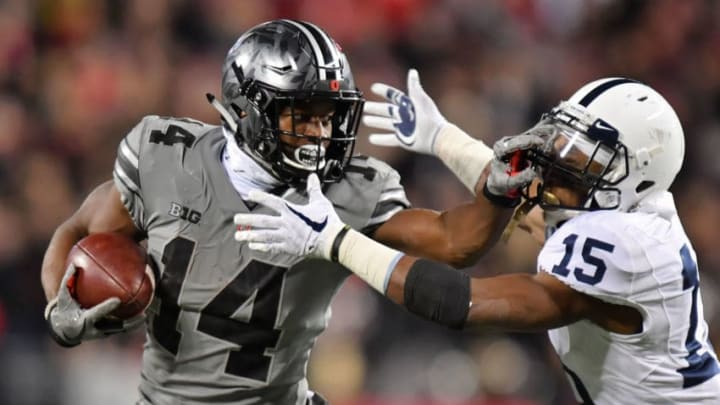 COLUMBUS, OH - OCTOBER 28: K.J. Hill #14 of the Ohio State Buckeyes stiff arms Grant Haley #15 of the Penn State Nittany Lions at Ohio Stadium on October 28, 2017 in Columbus, Ohio. Ohio State defeated Penn Statte 39-38. (Photo by Jamie Sabau/Getty Images)