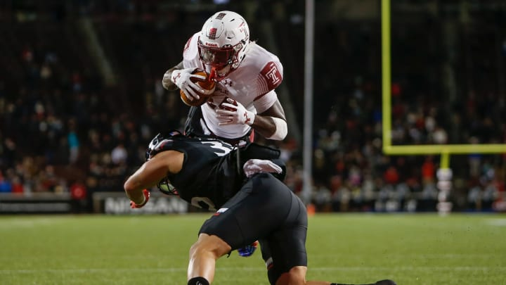 David Hood #24 of the Temple Owls hit by James Wiggins #32 of the Cincinnati Bearcats (Photo by Michael Reaves/Getty Images)