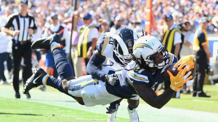 LOS ANGELES, CA - SEPTEMBER 23: Mike Williams #81 of the Los Angeles Chargers dives into the end zone to score a touchdown in front of Lamarcus Joyner #20 of the Los Angeles Rams during the third quarter of the game at Los Angeles Memorial Coliseum on September 23, 2018 in Los Angeles, California. (Photo by Harry How/Getty Images)