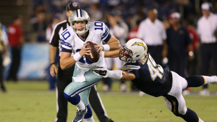 SAN DIEGO, CA - AUGUST 07: Dustin Vaughan #10 of the Dallas Cowboys is chased by Colton Underwood #49 of the San Diego Chargers during a preseason game at Qualcomm Stadium on August 7, 2014 in San Diego, California. (Photo by Stephen Dunn/Getty Images)
