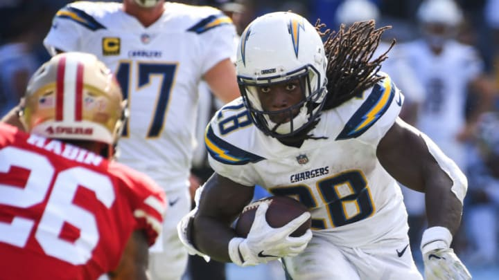CARSON, CA - SEPTEMBER 30: Running back Melvin Gordon #28 of the Los Angeles Chargers runs the ball by cornerback Greg Mabin #26 of the San Francisco 49ers at StubHub Center on September 30, 2018 in Carson, California. (Photo by Jayne Kamin-Oncea/Getty Images)