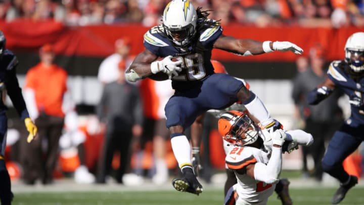 CLEVELAND, OH - OCTOBER 14: Melvin Gordon #28 of the Los Angeles Chargers leaps over Denzel Ward #21 of the Cleveland Browns in the second half at FirstEnergy Stadium on October 14, 2018 in Cleveland, Ohio. The Los Angeles Chargers won 38 to 14. (Photo by Gregory Shamus/Getty Images)