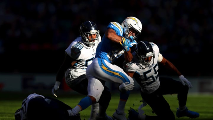 LONDON, ENGLAND - OCTOBER 21: Austin Ekeler of Los Angeles Chargers is brought down by Jayon Brown of Tennessee Titans during the NFL International Series match between Tennessee Titans and Los Angeles Chargers at Wembley Stadium on October 21, 2018 in London, England. (Photo by Naomi Baker/Getty Images)