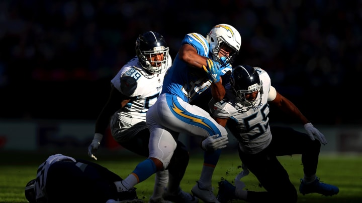 LONDON, ENGLAND – OCTOBER 21: Austin Ekeler of Los Angeles Chargers is brought down by Jayon Brown of Tennessee Titans during the NFL International Series match between Tennessee Titans and Los Angeles Chargers at Wembley Stadium on October 21, 2018, in London, England. (Photo by Naomi Baker/Getty Images)