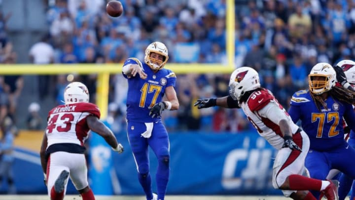 CARSON, CA - NOVEMBER 25: Philip Rivers #17 of the Los Angeles Chargers passes the ball under pressure from Robert Nkemdiche #90 and Haason Reddick #43 of the Arizona Cardinals during the second half of a game at StubHub Center on November 25, 2018 in Carson, California. (Photo by Sean M. Haffey/Getty Images)