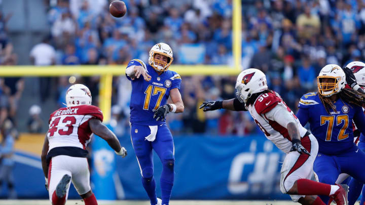 CARSON, CA – NOVEMBER 25: Philip Rivers #17 of the Los Angeles Chargers passes the ball under pressure from Robert Nkemdiche #90 and Haason Reddick #43 of the Arizona Cardinals during the second half of a game at StubHub Center on November 25, 2018 in Carson, California. (Photo by Sean M. Haffey/Getty Images)