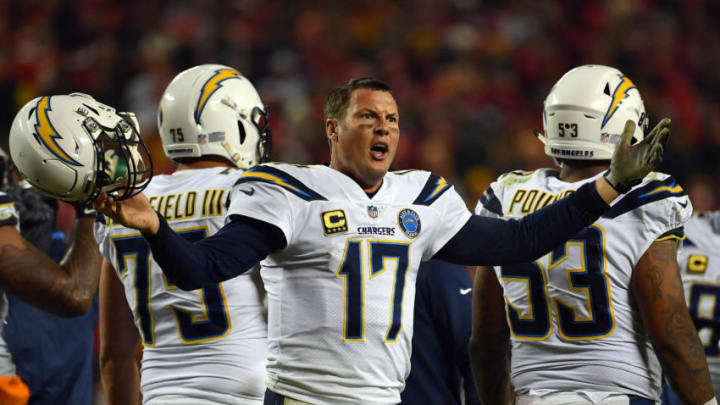 KANSAS CITY, MISSOURI - DECEMBER 13: Quarterback Philip Rivers #17 of the Los Angeles Chargers protests a non-call after being hit in the helmet during the game against the Kansas City Chiefs at Arrowhead Stadium on December 13, 2018 in Kansas City, Missouri. (Photo by Peter Aiken/Getty Images)