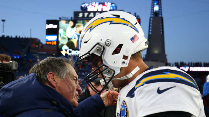 FOXBOROUGH, MASSACHUSETTS - JANUARY 13: Head coach Bill Belichick of the New England Patriots hugs Philip Rivers #17 of the Los Angeles Chargers after the AFC Divisional Playoff Game at Gillette Stadium on January 13, 2019 in Foxborough, Massachusetts. (Photo by Adam Glanzman/Getty Images)
