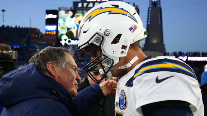 FOXBOROUGH, MASSACHUSETTS – JANUARY 13: Head coach Bill Belichick of the New England Patriots hugs Philip Rivers #17 of the Los Angeles Chargers after the AFC Divisional Playoff Game at Gillette Stadium on January 13, 2019 in Foxborough, Massachusetts. (Photo by Adam Glanzman/Getty Images)