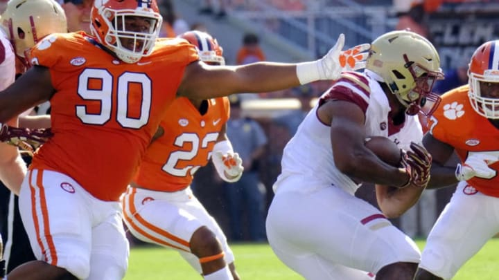 CLEMSON, SC - SEPTEMBER 23: Defensive tackle Dexter Lawrence #90 of the Clemson Tigers tries to grab running back AJ Dillon #2 of the Boston College Eagles at Memorial Stadium on September 23, 2017 in Clemson, South Carolina. (Photo by Todd Bennett/Getty Images)