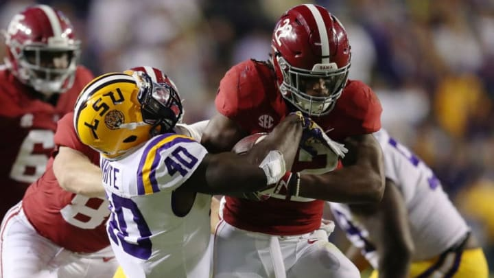 BATON ROUGE, LA - NOVEMBER 03: Najee Harris #22 of the Alabama Crimson Tide battles for yards while being tackled by Devin White #40 of the LSU Tigers during a second half run at Tiger Stadium on November 3, 2018 in Baton Rouge, Louisiana. Alabama won the game 29-0. (Photo by Gregory Shamus/Getty Images)