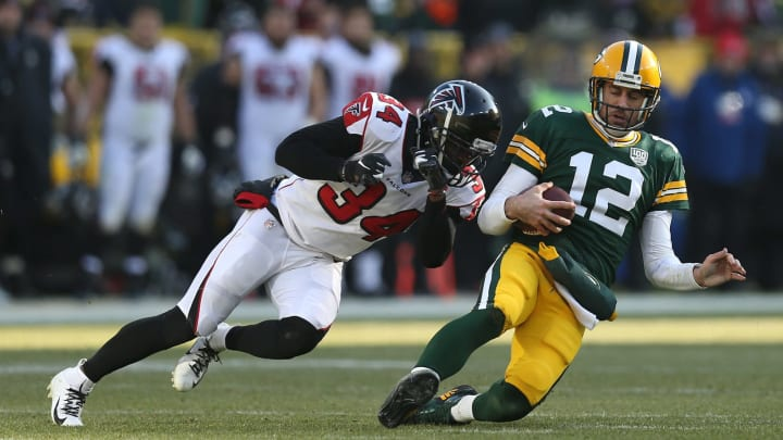 GREEN BAY, WISCONSIN – DECEMBER 09: Aaron Rodgers #12 of the Green Bay Packers is tackled by Brian Poole #34 of the Atlanta Falcons during the first half of a game at Lambeau Field on December 09, 2018 in Green Bay, Wisconsin. (Photo by Dylan Buell/Getty Images)