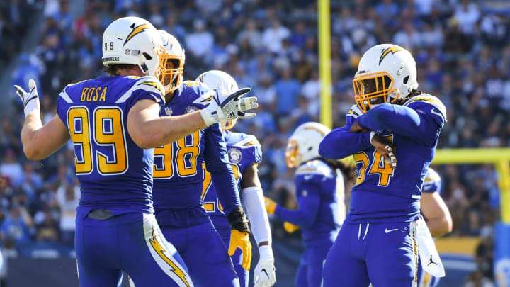 CARSON, CA – NOVEMBER 25: Defensive end Joey Bosa #99 of the Los Angeles Chargers celebrates his sack with defensive end Melvin Ingram #54 in the second quarter against the Arizona Cardinals at StubHub Center on November 25, 2018, in Carson, California. (Photo by Harry How/Getty Images)