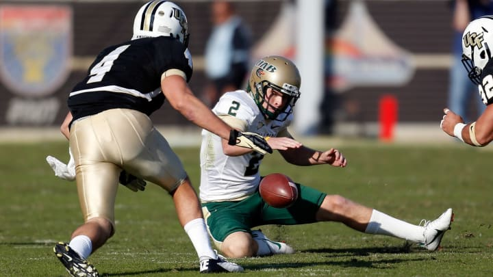ORLANDO, FL – NOVEMBER 24: Kicker Ty Long #2 of the Alabama Birmingham Blazers recovers an onside kick against the Central Florida Knights during the game at Bright House Networks Stadium on November 24, 2012, in Orlando, Florida. (Photo by J. Meric/Getty Images)