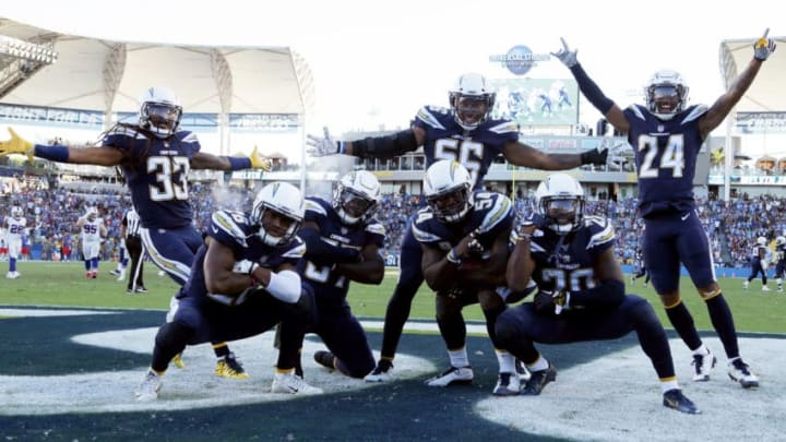 CARSON, CA - NOVEMBER 19: The Los Angeles Chargers defense celebrate after an interception during the NFL game against the Buffalo Bills at the StubHub Center on November 19, 2017 in Carson, California. (Photo by Jeff Gross/Getty Images)