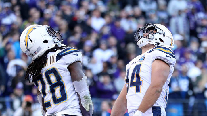 BALTIMORE, MARYLAND – JANUARY 06: Melvin Gordon #28 of the Los Angeles Chargers celebrates with Derek Watt #34 after scoring a one yard touchdown against the Baltimore Ravens during the fourth quarter in the AFC Wild Card Playoff game at M&T Bank Stadium on January 06, 2019 in Baltimore, Maryland. (Photo by Patrick Smith/Getty Images)