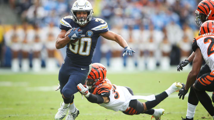 CARSON, CA – DECEMBER 09: Running back Austin Ekeler #30 of the Los Angeles Chargers makes a short run in the first quarter in front of free safety Jessie Bates #30 of the Cincinnati Bengals at StubHub Center on December 9, 2018 in Carson, California. (Photo by Sean M. Haffey/Getty Images)