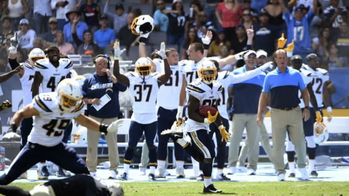 CARSON, CA - AUGUST 18: Troymaine Pope #35 of the Los Angeles Chargers runs back a punt for a touchdown during the first half of their pre seaon football game against New Orleans Saints at Dignity Health Sports Park on August 18, 2019 in Carson, California. (Photo by Kevork Djansezian/Getty Images)