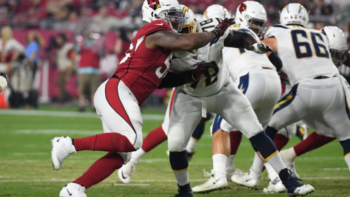 GLENDALE, ARIZONA - AUGUST 08: Terrell Suggs #56 of the Arizona Cardinals rushes the passer against Trent Scott #78 of the Los Angeles Chargers during the first half of an NFL preseason game at State Farm Stadium on August 08, 2019 in Glendale, Arizona. (Photo by Norm Hall/Getty Images)