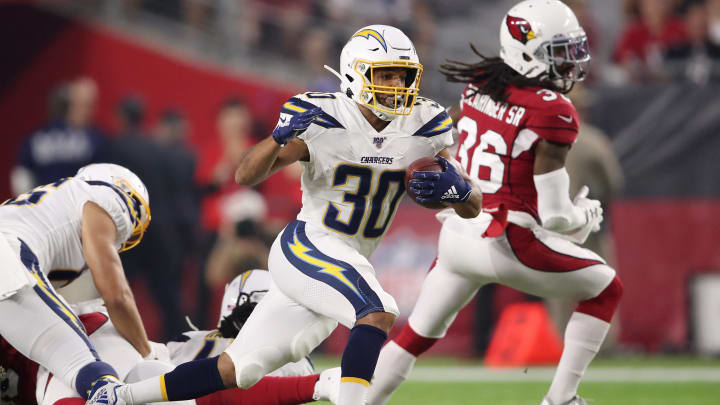 GLENDALE, ARIZONA – AUGUST 08: Austin Ekeler #30 of the Los Angeles Chargers carries the ball during a preseason game against the Arizona Cardinals at State Farm Stadium on August 08, 2019 in Glendale, Arizona. (Photo by Christian Petersen/Getty Images)