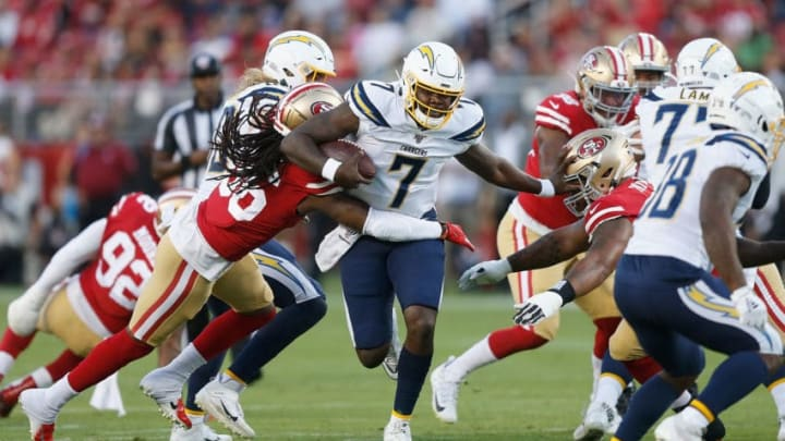 SANTA CLARA, CALIFORNIA - AUGUST 29: Quarterback Cardale Jones #7 of the Los Angeles Chargers is tackled by Marcell Harris #36 and Jullian Taylor #77 of the San Francisco 49ers during the preseason game at Levi's Stadium on August 29, 2019 in Santa Clara, California. (Photo by Lachlan Cunningham/Getty Images)