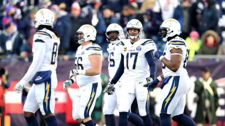 FOXBOROUGH, MASSACHUSETTS – JANUARY 13: Philip Rivers #17 of the Los Angeles Chargers reacts with teammates during the third quarter in the AFC Divisional Playoff Game against the New England Patriots at Gillette Stadium on January 13, 2019 in Foxborough, Massachusetts. (Photo by Elsa/Getty Images)
