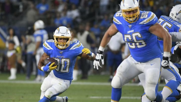 CARSON, CA - AUGUST 24: Austin Ekeler #30 of the Los Angeles Chargers follows the block of Dan Feeney #66 of the Los Angeles Chargers while playing the Seattle Seahawks in the first quarter of a pre-season NFL football game at Dignity Health Sports Park on August 24, 2019 in Carson, California. (Photo by John McCoy/Getty Images)