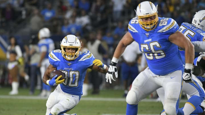 CARSON, CA – AUGUST 24: Austin Ekeler #30 of the Los Angeles Chargers follows the block of Dan Feeney #66 of the Los Angeles Chargers while playing the Seattle Seahawks in the first quarter of a pre-season NFL football game at Dignity Health Sports Park on August 24, 2019 in Carson, California. (Photo by John McCoy/Getty Images)