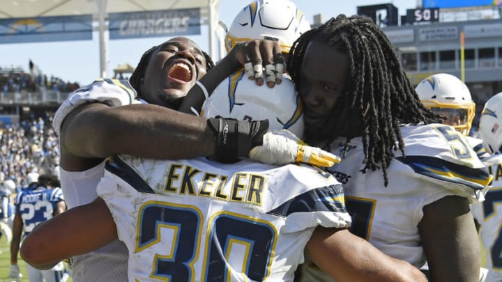 CARSON, CA - SEPTEMBER 08: Running back Austin Ekeler #30 of the Los Angeles Chargers is congratulated by Justin Jones #93 and Melvin Ingram #54 after scoring the winning touchdown in overtime against Indianapolis Colts at Dignity Health Sports Park on September 8, 2019 in Carson, California. (Photo by Kevork Djansezian/Getty Images)